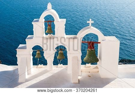 Traditional White Blue Christian Church Dome Belfry And Metal Bells. Santorini Island In Greece. Gre