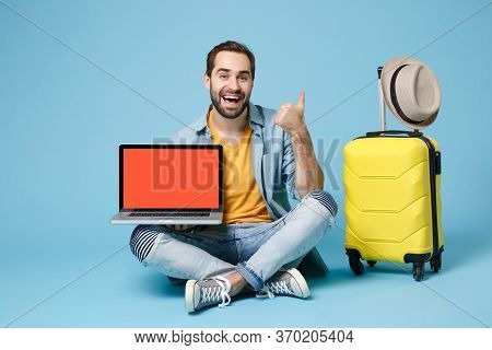 Cheerful Traveler Tourist Man In Yellow Clothes Isolated On Blue Background. Passenger Traveling Abr