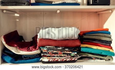 Clothes Neatly Folded On Shelves. Stack Of Colorful Clothing. Horizontal Shot. Web Banner