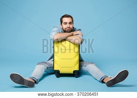 Boring Traveler Tourist Man In Summer Yellow Casual Clothes Isolated On Blue Wall Background. Male P