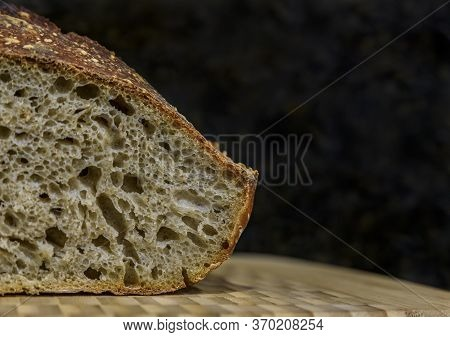Close Up Of A Sliced Freshly Baked Loaf Of Artisanal Whole Wheat And Dark Rye Rustic Sourdough Bread