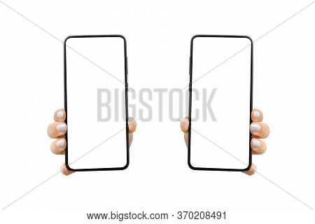 Woman's Hand Shows Mobile Smartphone With White Screen In Vertical Position. Mock Up Mobile. Isolate