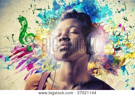 Black girl listening to the music with a pair of headphones