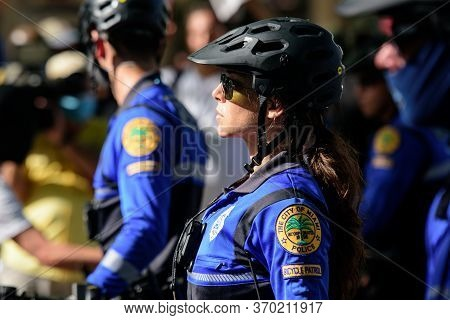 Miami Downtown, Fl, Usa - May 31, 2020: Us Patrol Police. Female Police Officer.