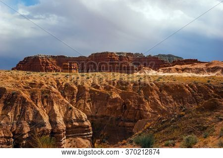 Hoodoo - geological formations. USA. Scenic Utah state park Goblin Valley. Picturesque huge figures of red-brown sandstone formed as a result of erosion. The concept of active,  and photo tourism