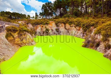 Devil's Bath with green water. The unique geothermal area of Rotorua. Volcanic Valley Waimangu, Wai-O-Tapu. New Zealand, North Island. Extreme, exotic and photo tourism concept