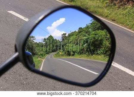 Looking Into The Rear View Scooter Mirror I See The Road I Came From. Alone On A Road I Took A Pictu