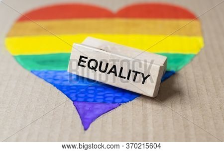 Gay Pride Flag With The Word Equality Written On A Block. Lgbtq Equality Concept