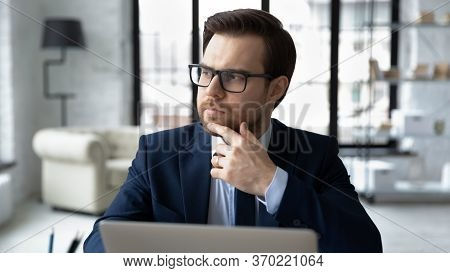 Pensive Male Boss Look In Distance Thinking Pondering