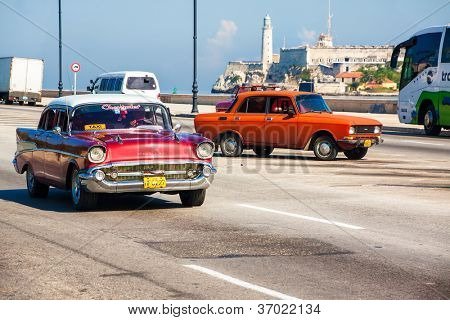 HAVANA-SEPTEMBER 4:Old Chevrolet with the castle of El Morro in the background September 4,2012 in Havana.Thousands of these cars are still used in Cuba and have become a famous image of the country