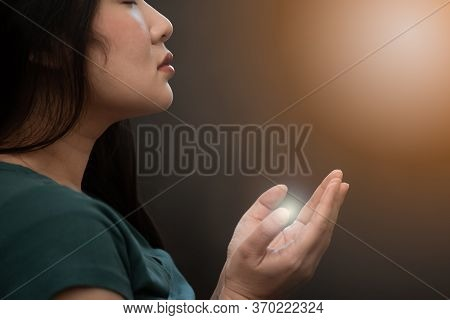 Woman Praying And Worship To God Using Hands To Pray In Religious Beliefs And Worship Christian In T