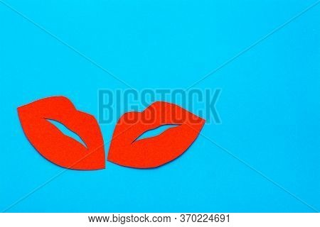 World Kiss Day. A Pair Of Red Cardboard Lips On A Blue Background. Copy Space