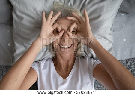 Portrait Of Overjoyed Elderly Woman Have Fun At Home