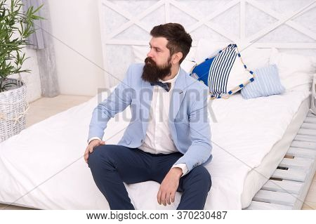 Ready For Bachelor Party. Bachelor With Hipster Beard Sit On Bed. Single Man In Formalwear. Celebrat