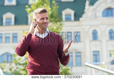 Are You Ok To Talk. Happy Man Talk On Phone Urban Outdoor. Talk Business. Sales Talk. Telephone Surv