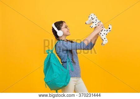 Learning Through Play. Happy Girl Play With Soft Dog. Playing With Toy. Toy Shop. Playing Games. Chi