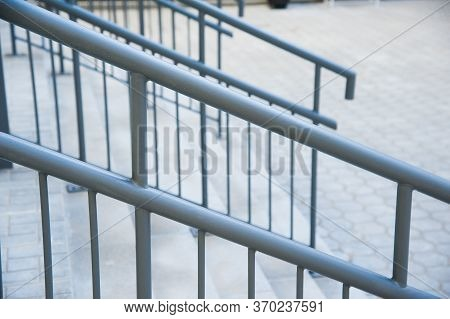 Concrete Entrance Stairs With Metal Railings