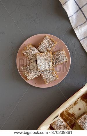 Homemade Tasty Applesauce Cake On A Pink Plate On A Gray Background, Top View. Flat Lay, Overhead, F