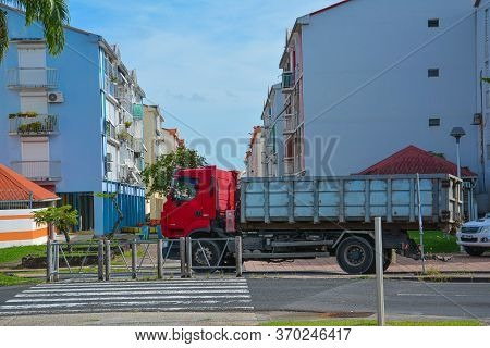 Point-a-pitre, Guadeloupe - Sept 17, 2018: Driver Parked A Truck With A Red Cab On The Sidewalk Near