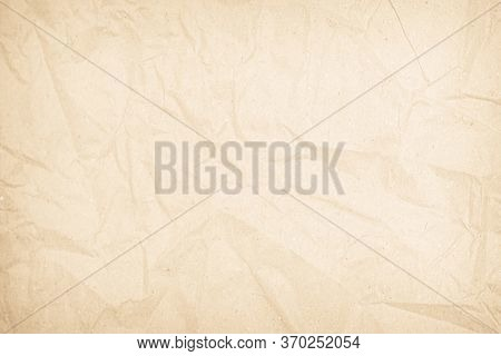 Brown Or Cream Recycled Craft Paper Texture Background. Pattern