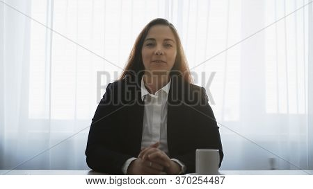 Distant Teacher Smiling, Looks At Camera And Talking With Remote Student Or Friend, Webinar Or Onlin