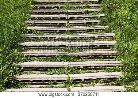 Improvised Stairs Made Of Improvised Materials, Concrete Slabs And Structures With Cracks And Other