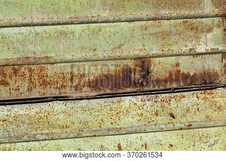 Green-painted Metal Surface That Still Started To Oxidize And Rust, Damaged Metal, Close Up