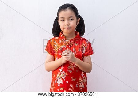 Asian Girl Wear Cheongsam With Gesture Of Congratulation, Bring The Hands Together In Greeting. In C