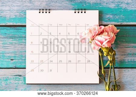 Carnation Flower And Calendar On Wood Background, Valentine's Day, Mother's Day Or Birthday Backgrou