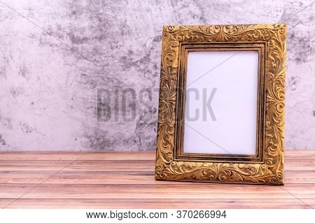 Picture Frame On Wall Background And Wooden Table. Poster Product Design Styled