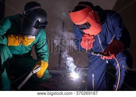 Metal Welding Steel Works Using Electric Arc Welding Machine