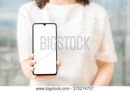 Woman Showing Blank Screen Mobile Phone While Standing, Women Hand Show The Mobile Phone At The Whit