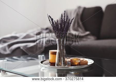 Living Room Decor: Glass Coffee Table With Dried Lavender Bouquet And Aroma Candles On A Metal Tray,