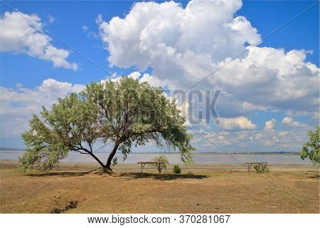 The Photograph Shows The Restrained Beauty Of Odessa Estuaries. Huge Clouds Walk Over The Water Surf