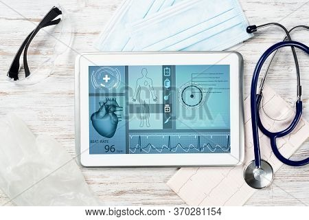Medical Diagnostics In Hospital. Tablet Computer With Medical App Interface On Screen. Doctor Workpl