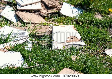 Construction Debris Is Dumped In The Grass By The Side Of The Road. Discarded Ceramic Tiles. Polluti