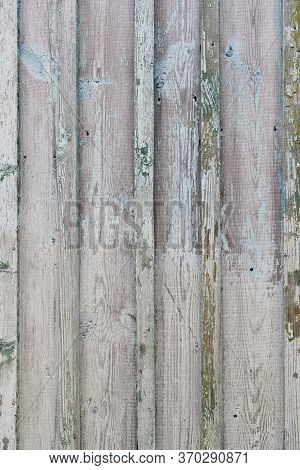 Faded Old Boards With Shabby Turquoise Paint. Part Of An Old Wooden House In The Countryside. Old Sh