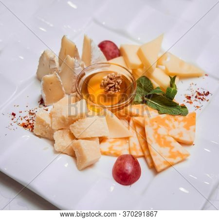 Camembert Cheese, Figs, Jamon, Honey And Grapes.