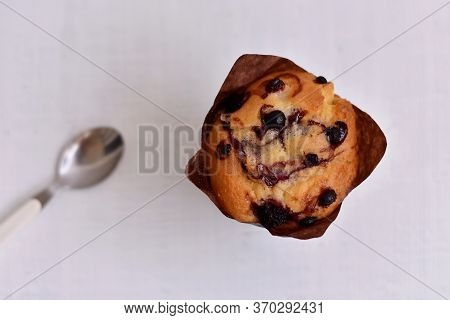 Delicious Freshly Baked Sweet Muffin/ Home Made Sweet Blueberry Muffin On A Table On White Wooden Ba