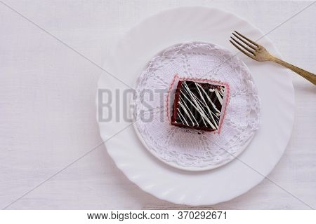Brownies Topped With Chocolate In A White Dish, Placed On A Wooden Table And Ready To Eat/ Delicious