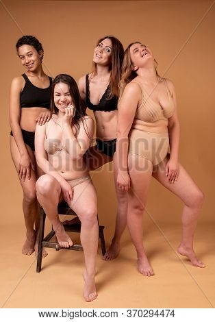 Beautiful Fat Girls In Black Lingerie On Pink Background. Body Positive Concept. Group Of Women With