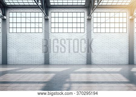 Modern Warehouse Interior With Window And Blank Brick Wall. Industrial And Exhibition Concept. 3d Re
