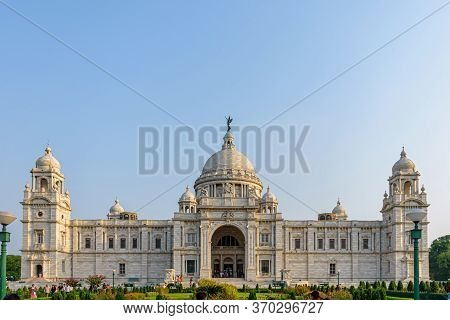View Of Victoria Memorial Kolkata With Vibrant Moody Sky In The Background. Victoria Memorial Is A M