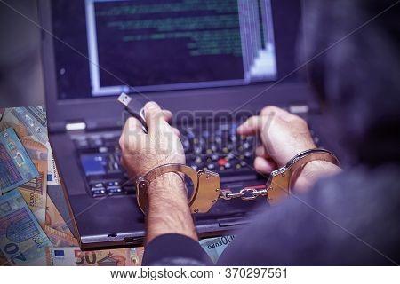 Hands Of Arrested Hacker In Handcuffed. Prisoner Or Arrested Terrorist, Closeup Of Hands In Handcuff