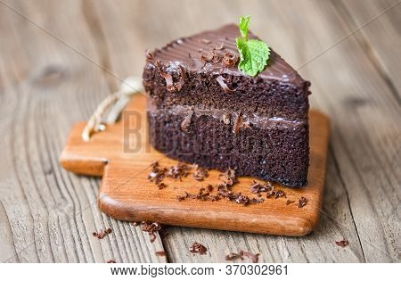 Cake Chocolate Delicious Dessert Served On The Table / Cake Slice On Wooden Cutting Board Background