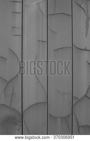 Vertical Metal Siding Gray Color With Cracks And Erosion, Old Wall Sheathing Surface, Textured Effec