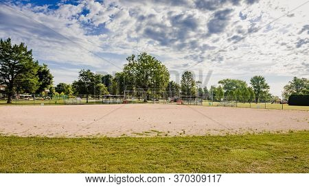 The View From The Outfield Of A Youth Baseball Field In A City Park