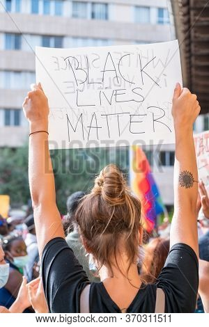 Palma, Majorca, Spain - June 7, 2020: Woman Holding A Banner During Demonstration Against Racism. Bl
