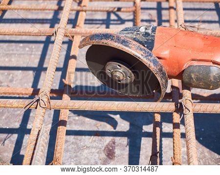 Angle Grinder And Reinforcement Framework Of Concrete Slab