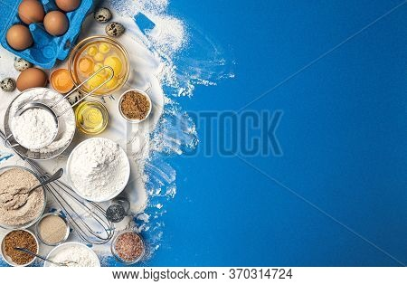 Baking Ingredients On Blue Color Background, Top View